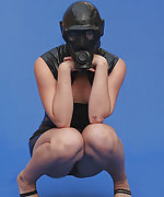 Cute latex girl has some fun with gas mask