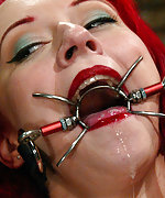 Redhead roped, ball-gagged, suspended and vibed