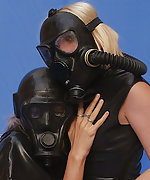 Two girls in latex and gas masks play with each other