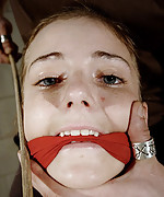 Tied and gagged girl gets breast and stomach caning