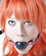 Redhead whore is tied and gagged on the bed