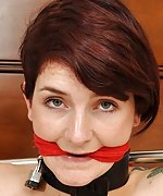 Naked, handcuffed, legcuffed, cleave-gagged