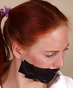 Sarah gets tightly roped and tape-gagged