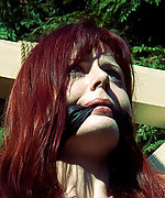 Redhead crucified and cleave-gagged outdoors