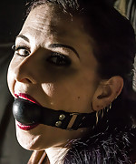 Brunette milf roped crucifed and ball-gagged