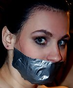 Mindy bound spreadeagle, tape-gagged, tit-grabbed