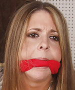 Pretty girl gets roped, cleave-gagged, and exposed