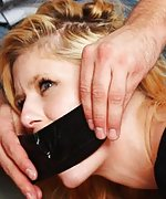 Blond gets captured, roped, mouth-stuffed and tape-gagged