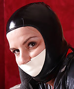 Latex catsuit, wrap, foam tape gag, hood