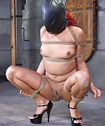 Redhead pain slut gets roped, hooded and dildoed