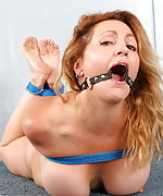 Busty milf hogtied and ball gagged