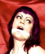 Gothic babe roped, handcuffed and cleave-gagged