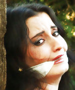 Brunette crucified and cleave-gagged in the forest
