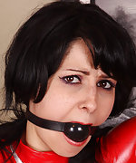 Latex brunette gets tied up, roped and ball-gagged