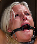 Blonde cums in extremely challenging bondage