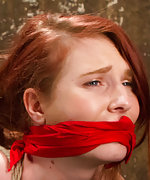 Pretty redhead gets tied, gagged, tormented and orgasmed