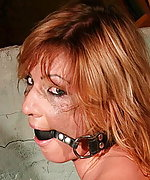 Gabriella is strapped, ball-gagged and fucked